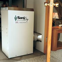 A basement dehumidifier with an ENERGY STAR® rating ducting dry air into a finished area of the basement  in Duncanville