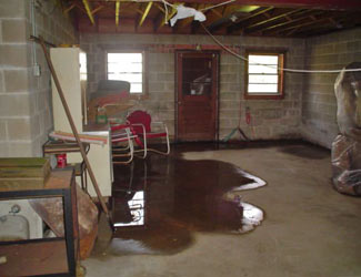 a flooded basement floor in a Duncanville home