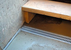 a hatchway entrance in Flower Mound that has been protected from flooding by our TrenchDrain basement drainage system.
