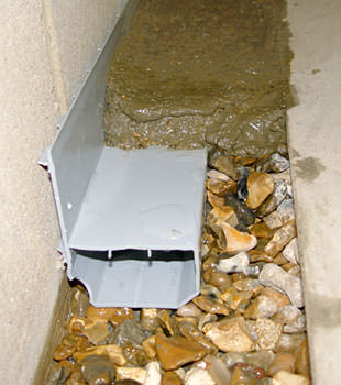 A basement drain system installed in a Mesquite home