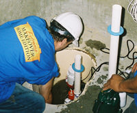 installing a sump pump and backup sump pump system in Mansfield, TX